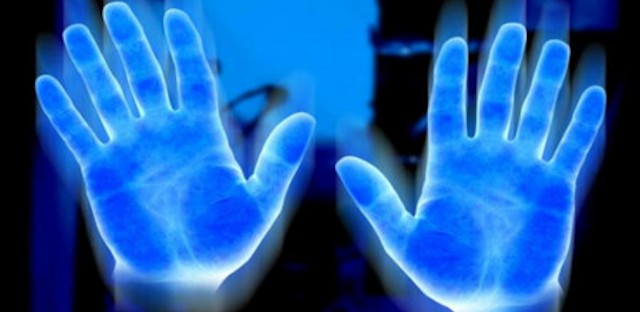 Biophotons: The Human Body Emits, Communicates with, and is Made from Light Hands-glowing-biophotons