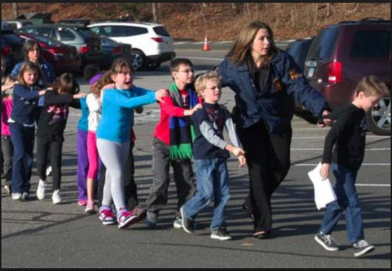 Teacher-leading-students-away-from-Sandy-Hook.jpg