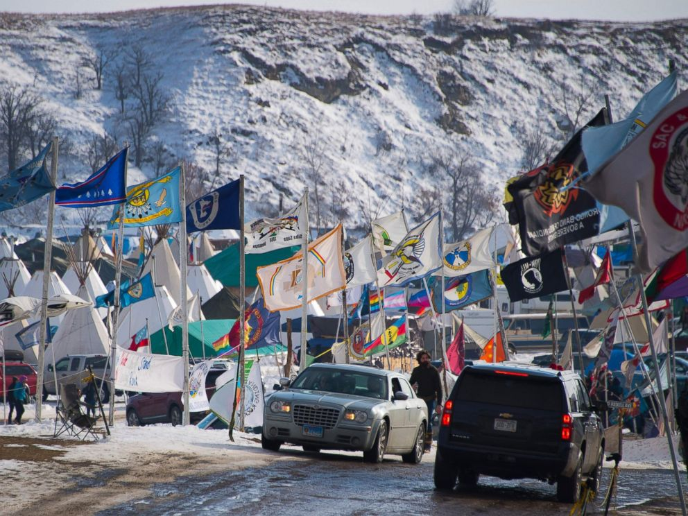 Flags flap in the wind on the main thoroughfare of Oceti Sakowin Camp on the edge of the Standing Rock Sioux