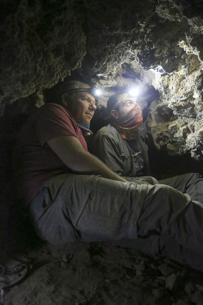"Archaeologists have unearthed a new cave associated with the famed Dead Sea Scrolls, filled with ancient storage jars and lids, marking the first successful excavation of its kind in 60 years. Until Wednesday, researchers assumed only 11 caves contained scrolls. But the discovery of a twelfth cave in the Judean desert cements a longstanding belief among archaeologists that looters stole the artifacts in the mid-1900s, referencing pick ax heads found deep inside a tunnel at the new cave's rear as proof. Hidden along the cave's walls, excavators found numerous broken jars and lids. Among the other findings were fragments of scroll wrappings, leather and string. The Dead Sea Scrolls are a collection of nearly 1,000 manuscripts written in Hebrew, Greek and Aramaic dating back to 4th century BC. The texts were first discovered in 1947 near modern-day West Bank by a Bedouin shepherd. ""This exciting excavation is the closest we've come to discovering new Dead Sea Scrolls in 60 years. Although at the end of the day no scroll was found... the findings indicate beyond any doubt that the cave contained scrolls that were stolen,"" Dr. Oren Gutfeld, an archaeologist at the Hebrew University's Institute of Archaeology and director of the excavation, said in a statement. Image: Hebrew University archeologists find 12th Dead Sea scrolls cave An undated handout photo made available by the Hebrew University of Jerusalem's Institute of Archaeology on Feb. 9, 2017 shows a remnant of a scroll after it was removed from a jar that has been discovered by archaeologists in a cave on the cliffs west of Qumran, near the northwestern shore of the Dead Sea, Israel. Casey L. Olson and Oren Gutfeld / EPA The discovery of pottery, flint blades, arrowheads and semi-precious stone suggest the new cave was used during the Neolithic period — an era that began in 10,200 BC and ended between 4,500 and 2,000 BC. Israel Hasson, Director-General of the Israel Antiquities Authority, said ""work remains to be done"" in the Judean Desert, with archaeologists in a ""race against time as antiquities thieves steal heritage assets worldwide for financial gain."" ""The important discovery of another scroll cave attests to the fact that a lot of work remains to be done in the Judean Desert and finds of huge importance are still waiting to be discovered,"" Hasson said. ""The State of Israel needs to mobilize and allocate the necessary resources in order to launch a historic operation, together with the public, to carry out a systematic excavation of all the caves of the Judean Desert."" Excavations into the caves of the Judean Desert will continue as part of Israel Antiquities Authority's ""Operation Scroll,"" officials said. Image: Hebrew University archeologists find 12th Dead Sea scrolls cave An undated handout photo made available by the Hebrew University of Jerusalem's Institute of Archaeology on Feb. 9, 2017 shows Israeli archeologists working in a cave on the cliffs west of Qumran, near the northwestern shore of the Dead Sea, Israel. Casey L. Olson and Oren Gutfeld / EPA"
