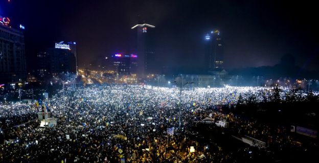 Protesters shone mobile phone torches and flashlights simultaneously during Sunday's rally in Bucharest